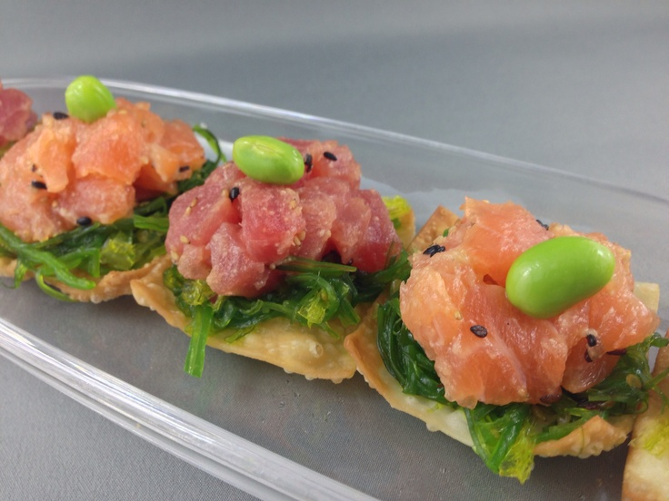 Miso glaze red tuna and salmon on a crispy wonton w/ wakame salad and ...