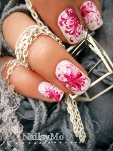 Here is the technique – apply one or two coat of the nail polish. Then make some dots with another colors. Then just take a pin and start to make some swirls.