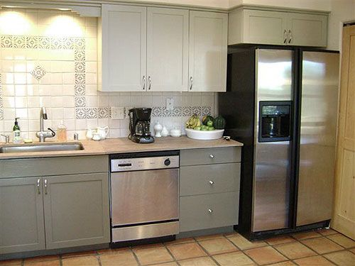 Khaki Kitchen Cabinet With Fretwork Ceramic Wall  http  www interior