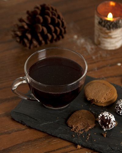... spiced wine, with brown sugar, dried fruits, and aromatic spices