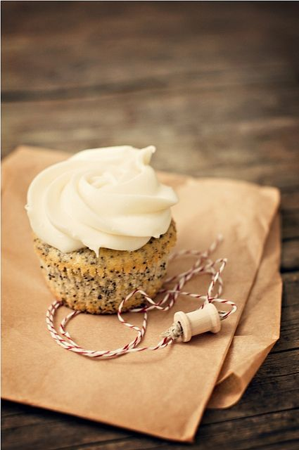 lemon poppy seed cupcake with vanilla cream cheese frosting
