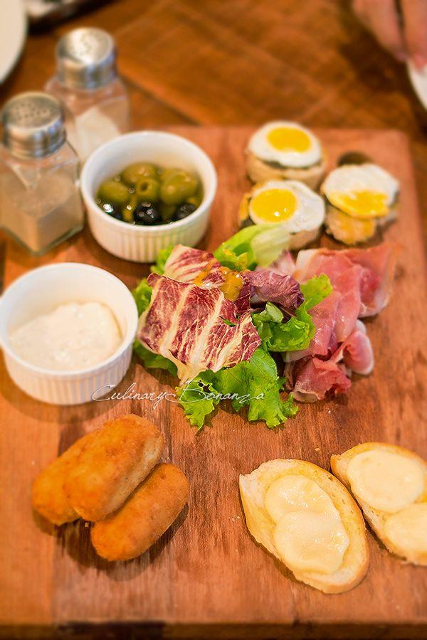Sharing Board: Prosciutto, tapenade toasts, chicken croquettes ...