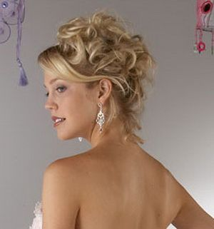 curly updo with tendrils at the neck