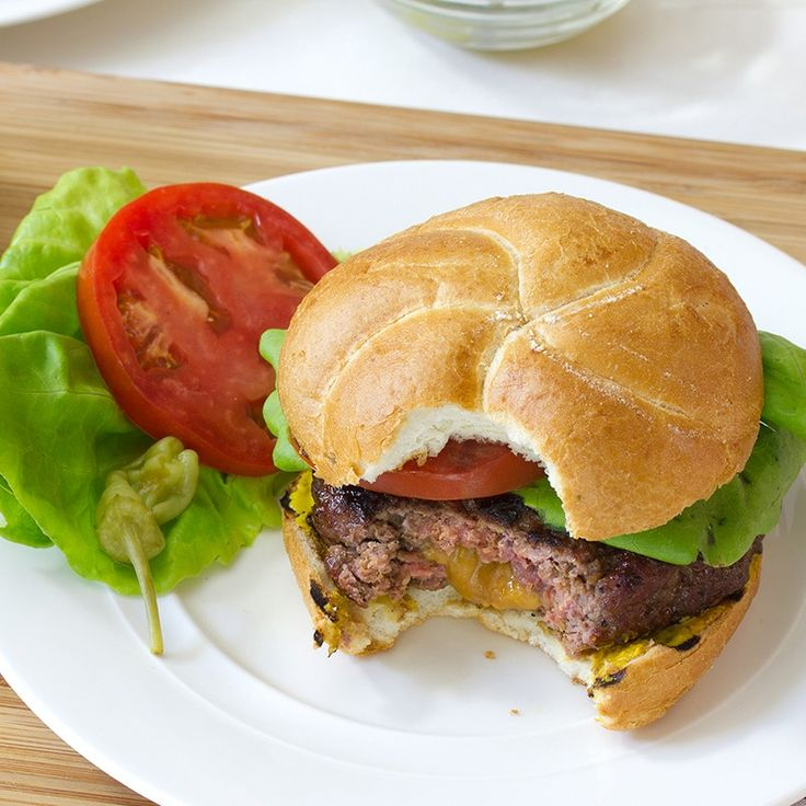 Stuffed Burgers Recipe - Oozing melted cheese makes these burgers ...