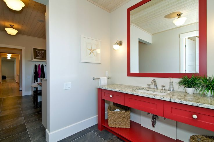 Love this red bathroom cabinetry.