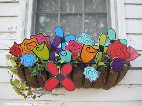 Window box flowers...these hang outside my studio and I love these.  I make these out of recycled signs. Colorful and so eco-friendly.