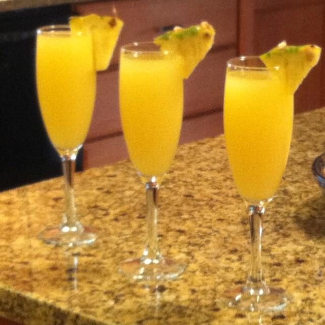 Orange-Pineapple Mimosa's :) Delish!