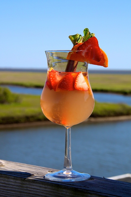 Sunrise Sangria made with Strawberries, Rhubarb and Tangerines.