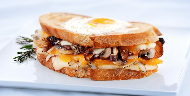 ... Aged Brick and Cheddar, a sunny-side-up egg, and sautéed mushrooms