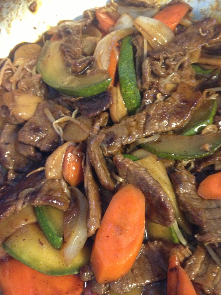 Beef stir fry: fry beef strips, add carrots, onions, zucchini, sprouts ...