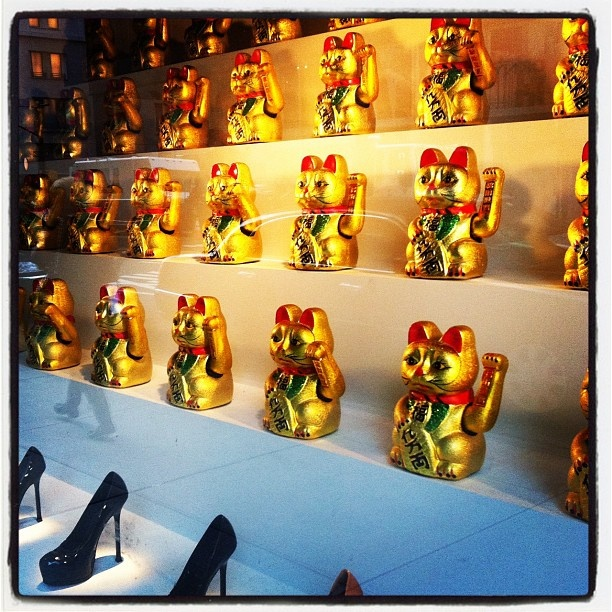 Maneki Neko in the window display at Barney's New York along with some patent black leather heels!