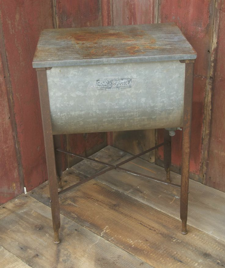 Antique washtub stand suds away washtub with lid metal for Old metal wash tub