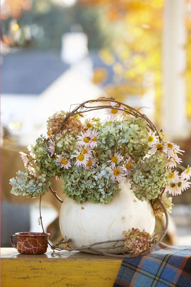 Use a pumpkin as a flower vase:) Great idea.