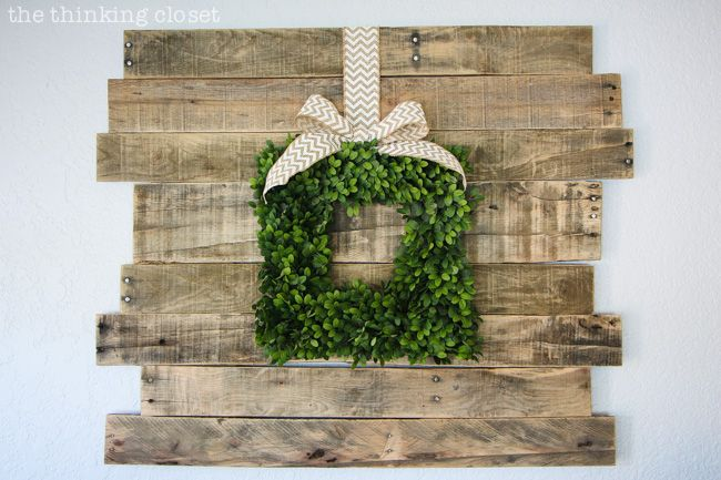 Rustic Vintage Spring Mantel: a pallet sign is the lovely backdrop for a boxwood wreath!  via @Lauren {TheThinkingCloset}