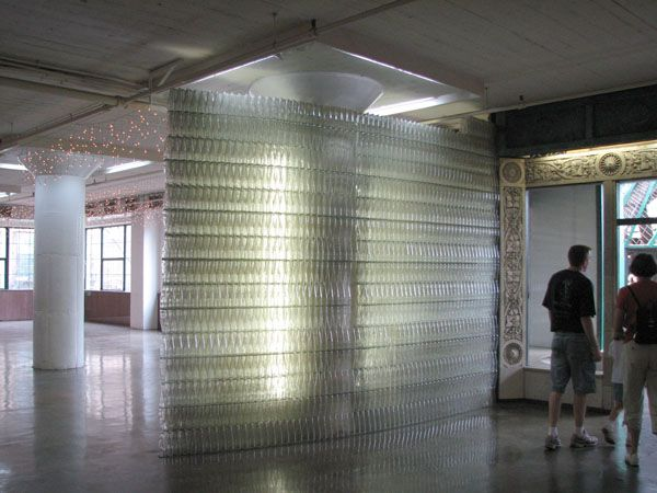 This is one of two clear bottle walls in the museum, near one of the exits leading to MonstroCity. Thee bottle are glued together with clear silcone caulk.