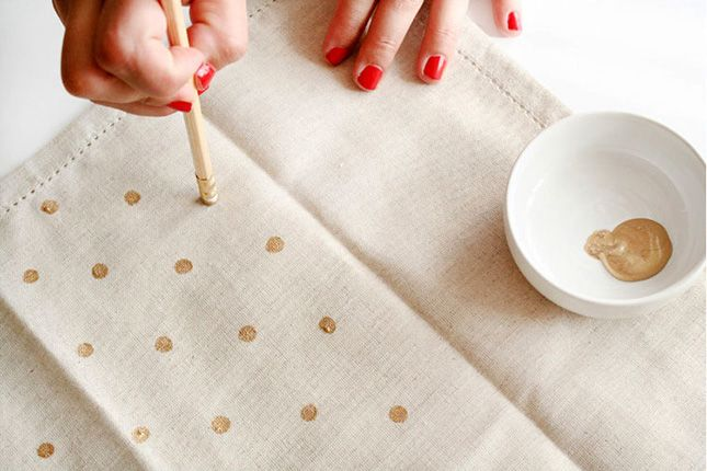 Use a pencil eraser and gold paint to DIY these patterned napkins.