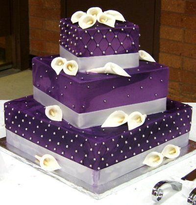 Oh so elegant purple Wedding cake. For more purple wedding ideas, go to the Squidoo website and then add at the end of the link: /purple-themed-wedding