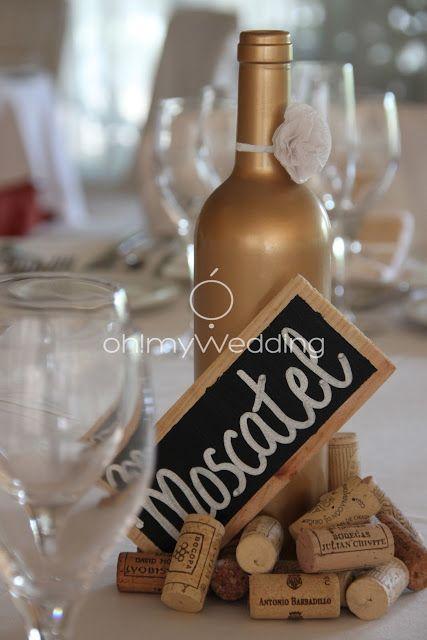 Wine bottle centerpiece painted gold auction ideas for Gold wine bottle centerpieces