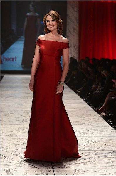 The Today Show's co-host Savannah Guthrie looked beautiful in her ruby red floor-length off-the-shoulder Carolina Herrera evening gown on the runway at the 2013 Heart Truth Red Dress Fashion Show in NYC.