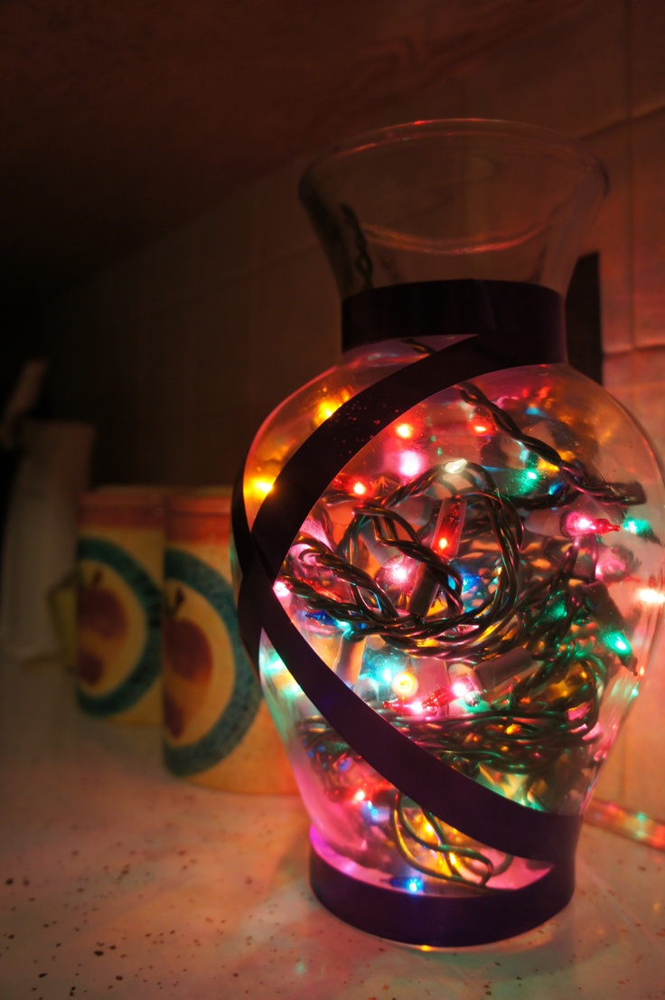 ... put colorful Christmas lights in this jar and wrapped it in ribbon