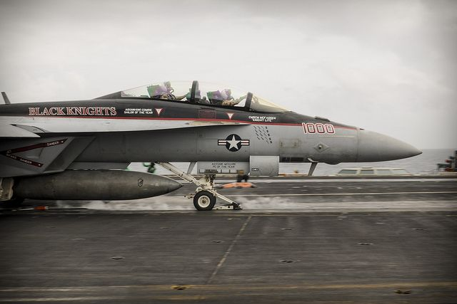 """GULF OF OMAN (Aug. 28, 2013) -- Capt. Kevin Mannix, commander, Carrier Air Wing (CVW) 11, right, and Capt. Rob Osterhoudt, deputy commander, CVW 11 launch from the flight deck of the aircraft carrier USS Nimitz (CVN 68) in an F/A-18F Super Hornet assigned to the """"Black Knights"""" of Strike Fighter Squadron (VFA) 154. Osterhoudt completed his 1,000th carrier arrested landing, or """"trap"""", aboard Nimitz Aug. 28. Nimitz Strike Group is deployed to the U.S. 5th Fleet area of responsibility conducting m…"""