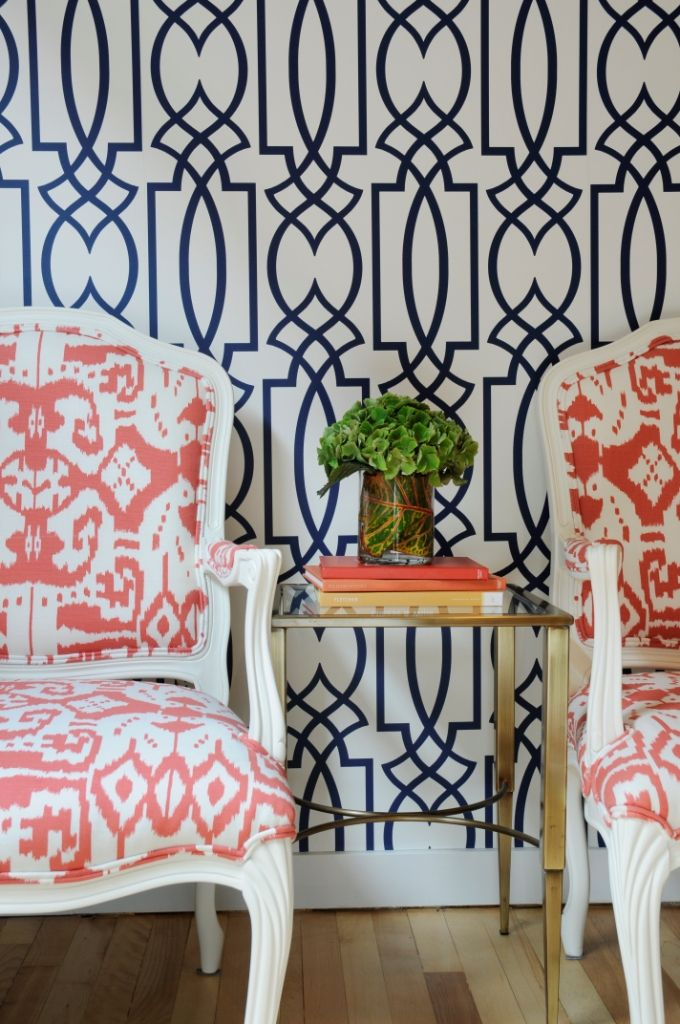 Great coloration - navy and coral. Wallpaper & vintage recycled chairs. interior design by corea sotropa via http://www.thepinkchandelier.ca