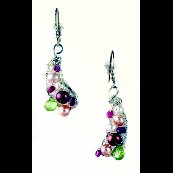 Covered with silver italian wire mesh each earring includes white
