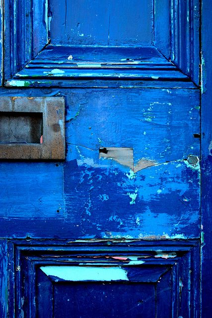 Blue and aqua painted weathered door