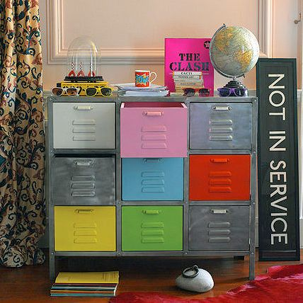 Great upcycle idea / Colorful painted file drawers interspersed with grey drawers in a grey file cabinet / Table Tonic