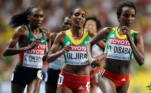 Tirunesh Dibaba Continues Her 10,000-Meter Dominance wins in 30:43.35, remaining unbeaten in 11 tries. In this picture Tirunesh Dibaba of Oromia  (Gold) leads Belaynesh Oljira of Oromia (Bronze) and Gladys Cherono of Kenya (Silver) in the women's 10,000 meters at Moscow World Athletics Champioship, 11 August 2013.  In Moscow's Luzhniki Stadium.