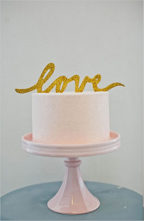 gold glitter love cake topper, see more here http://www.weddingchicks.com/2013/08/29/cake-toppers/