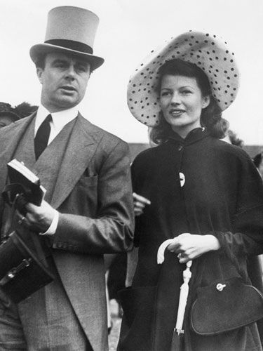 DAY AT THE RACES: 50 YEARS OF HATS & HORSES AROUND THE GLOBE - 1949: Rita Hayworth