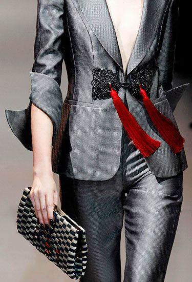 ..Stunning trousers suit split Geisha cuff detail & a cheeky Burlesque tassell -to titivate the Boss?? ,-)