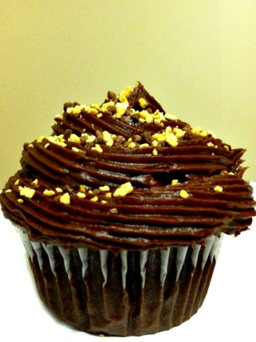 Chocolate cupcakes filled with Reese's peanut butter frosting and ...