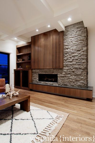 an asymmetrical fireplace wall transitional decor