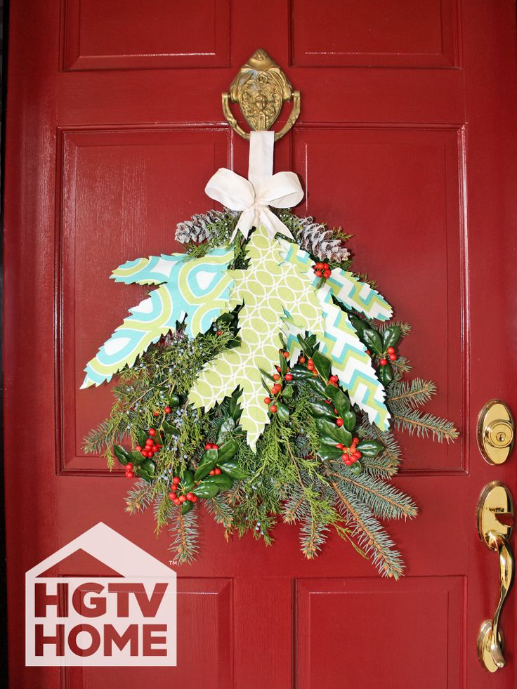 HGTV's @H. Camille Smith combined live evergreen, glittered pine cones, and beautiful HGTV HOME Fabric to create a vibrant and welcoming swag for the front door. #12DaysOfHGTVHOME How-to: http://www.hgtv.com/handmade/how-to-make-a-fabric-and-evergreen-holiday-swag/index.html