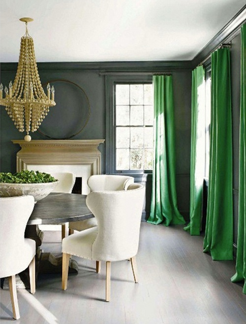 gorgeous white and grey dining room with emerald curtains