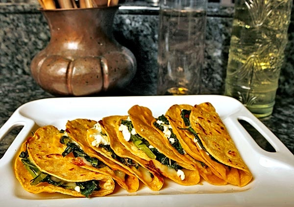 Quesadillas stuffed with greens and feta - one for me.