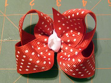 This is an awesome tutorial on how to make hairbows.  This is how I learned and I always go right back to it.  Easy Peasy!