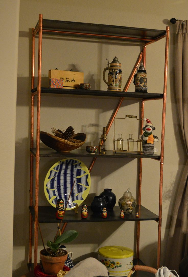 Copper pipe shelves made by father in law with stained plywood
