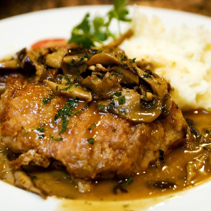 Pork chop with mushrooms, wine and thyme. Delicious! Use thinly sliced ...