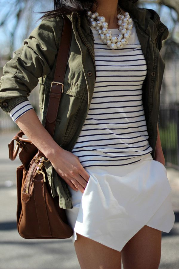Love the top with the military jacket, not crazy about the skirt, too short and an odd line.