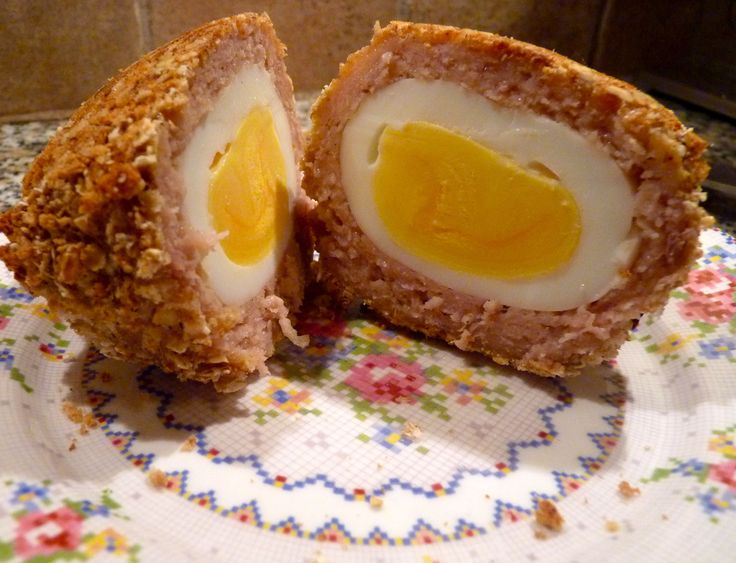Scotch egg - It's a boiled egg, surrounded by sausage, then ...