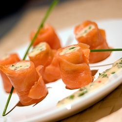Smoked salmon rolls filled with a spicy creamy mayonnaise and chives ...