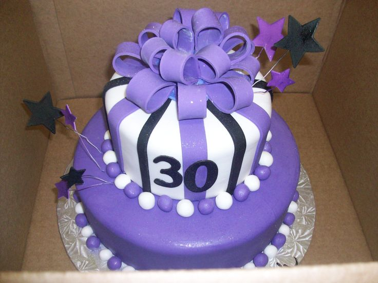 Calumet Bakery  Purple, Black and White Fondant Tiered cake with Bow Topper