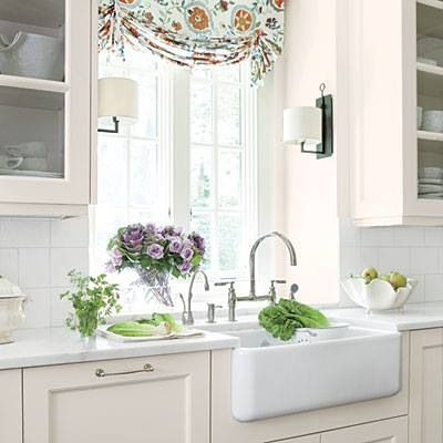 white farmhouse sink with white kitchen