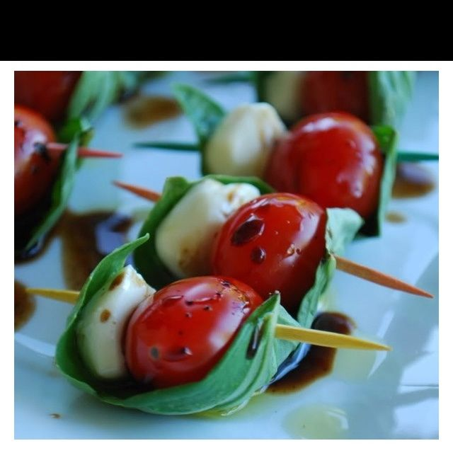 Cherry tomatoes, basil & mozzarella skewers with balsamic drizzle!