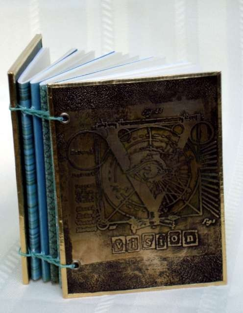 Beautiful etched metal book cover by Terrie