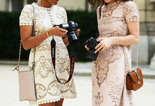 Lace dress, check! DSLR cameras, check! studded bag, check! Bloggers at Fashion Week!