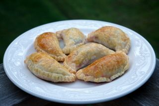 Baked empanadas filled with chard, goat cheese and beets